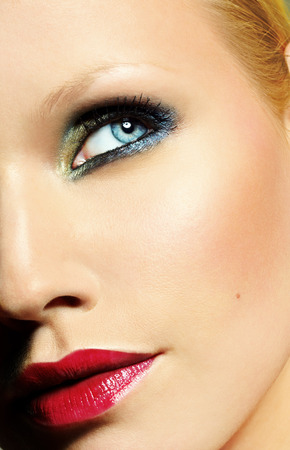 cropped shots: Closeup of a model with colorful makeup.