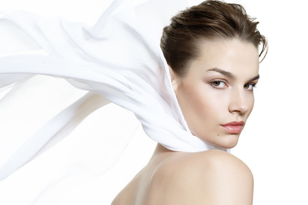 head scarf: Lightweight beauty visual with a caucasian model wearing a white silk scarf. Stock Photo