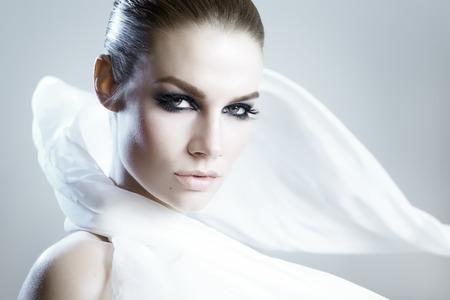 Beautiful woman wearing a white satin scarf. Banco de Imagens - 37773484