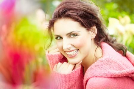 Happy young woman in garden.
