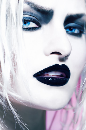 gothic woman: Closeup of a woman with gothic makeup.