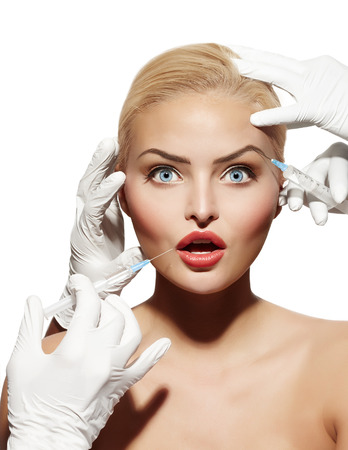 Young woman getting injectables. Banco de Imagens