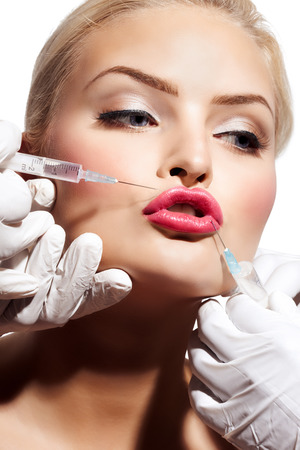 Closeup of a woman getting botox or filler done.