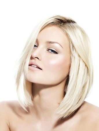 color hair: Blond woman with short sleek hair.