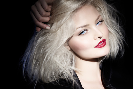 platinum hair: Platinum blond woman in black outfit. Stock Photo