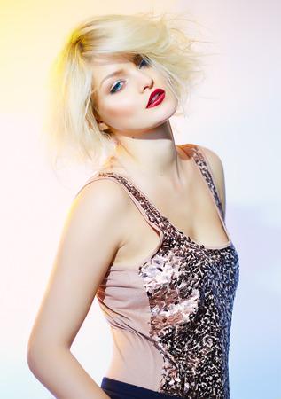 sequin: Woman posing in sequin top.