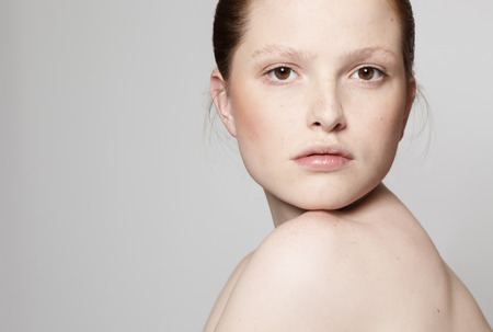 freckles: Young natural woman with freckles.