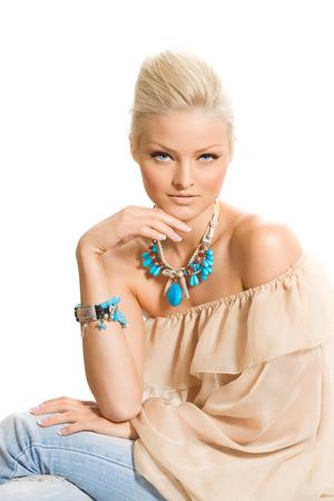 tunic: Blond odel posing in silk tunic and blue jewelery.
