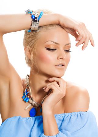 tunic: Tanned model posing in silk tunic and blue jewelery.