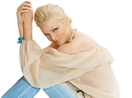 tunic: Tanned model posing in silk tunic and blue jewelery.