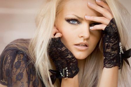 slight: Model wearing lace gloves. Slight grain. Stock Photo
