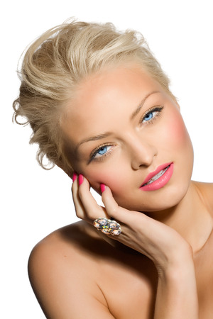 cropped shots: Closeup of a blond model wearing a large ring.