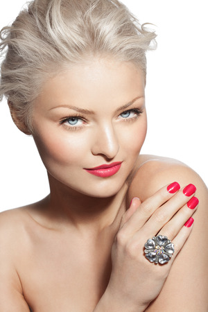 large woman: Young blond woman posing with large ring and raspberry colored make-up and manicure. Stock Photo