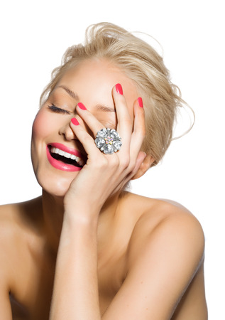 cropped shots: Closeup of a smiling model wearing a large ring. Stock Photo