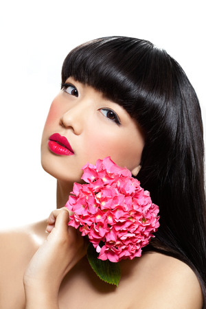 beauty shot: Asian woman with nice makeup and fresh flowers. Stock Photo