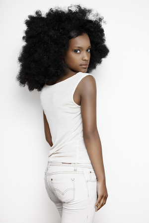 afro hair: African girl wearing casual white clothes.