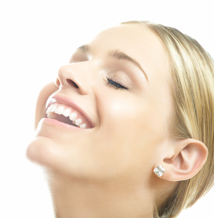 Young natural happy Caucasian woman in bright light over white background. Banco de Imagens