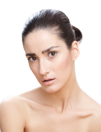 Young natural Caucasian woman with dark sleek hair.