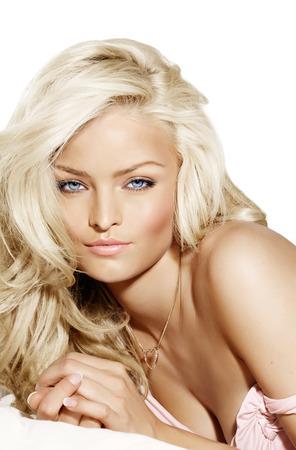 Beautiful blonde woman laying down.
