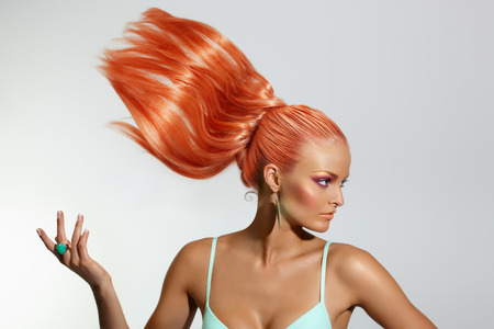 fashon: Red-haired model with flowing hair.