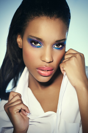 Young African American woman with colorful makeup.