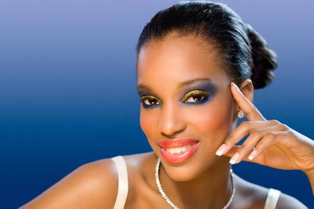 dark skin: Beautiful bride with dark skin and colorful makeup. Archivio Fotografico