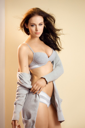 hair wind: Underwear and loungewear visual with a caucasian dark-haired model. Stock Photo