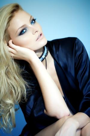 black silk: Model with lnog blond hair posing in black silk robe.