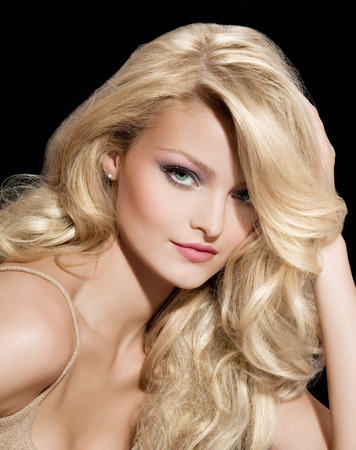 Fashion model with long blond hair. Stock Photo
