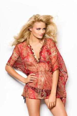 tunic: Model posing in red tunic top.