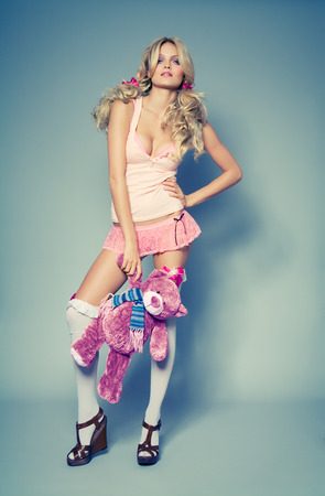 highs: Fashion model with teddy bear. Cross-processed color effect. Design of toy is altered.