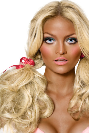 Model looking like a tanned doll.