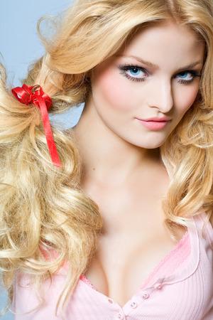 blonde  blue eyes: Dolled-up model. Stock Photo