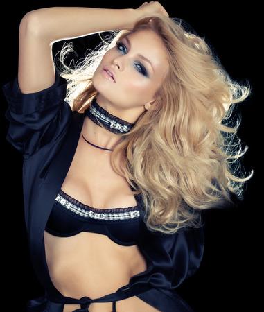 blonde  blue eyes: Model wearing lingerie set and black silk robe.