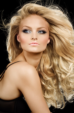 Model with long blond hair.