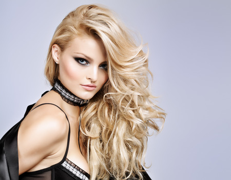 Robe: Blond fashion model wearing black silk robe.