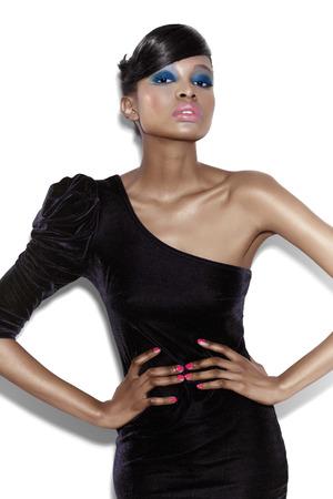 velvet dress: Model posing in dark velvet one-shoulder dress. Stock Photo