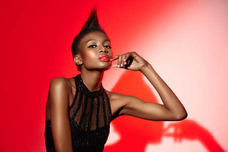 African fashion model wearing vintage sequin dress.