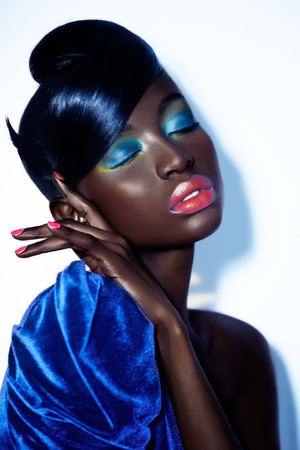 Dark model with colorful makeup.