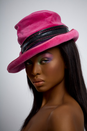 Model wearing a bright pink hat.