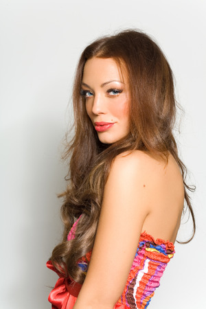 long red hair woman: Smiling woman with long hair.