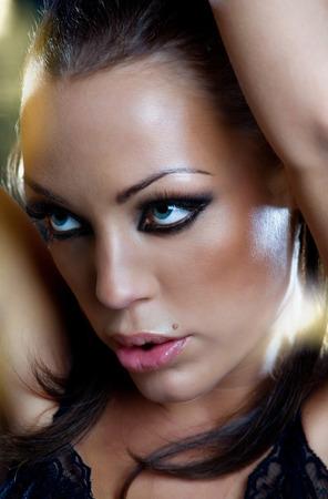slight: Closeup of a beautiful woman with confident look. Slight grain. Stock Photo