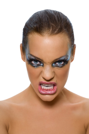 spiteful: Woman with scary expression. Stock Photo