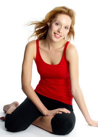 leggings: Young woman sitting on floor wearing sports outfit.