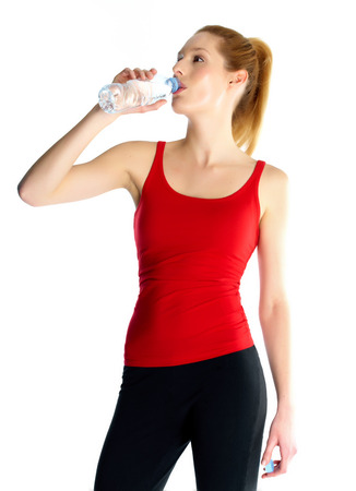 Woman drinking water after sport.