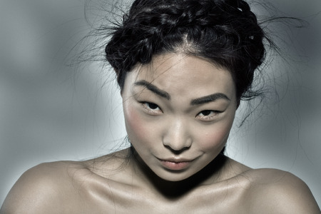 irony: Asian model with ironic expression.