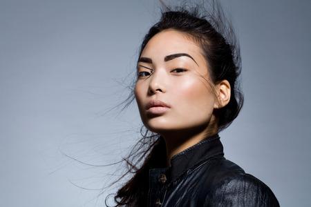 Asian model wearing biker jacket.