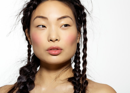 korean ethnicity: Beautiful Korean model with long hair styled into chaotic hairdo with many stray hairs.