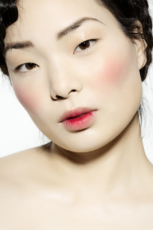 korean ethnicity: Korean model with very pale skin and bloody stain on lips. Stock Photo