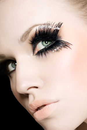 exaggerated: Model with exaggerated eyelaches.